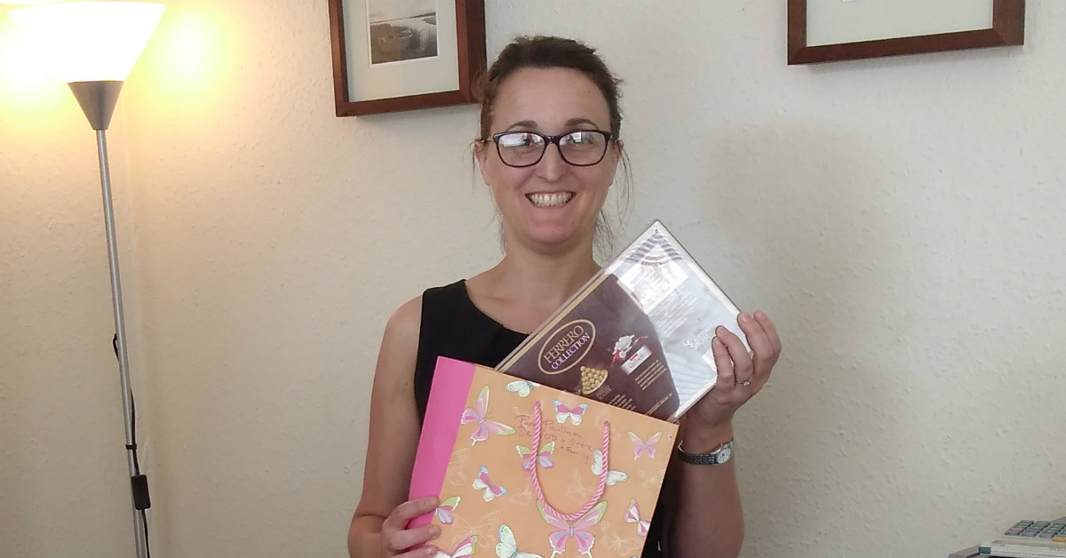 Jo receives a lovely box of chocolates from another very happy client