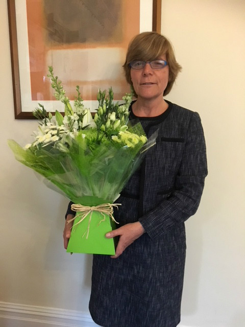 Sheldon receives lovely flowers from a very happy client!